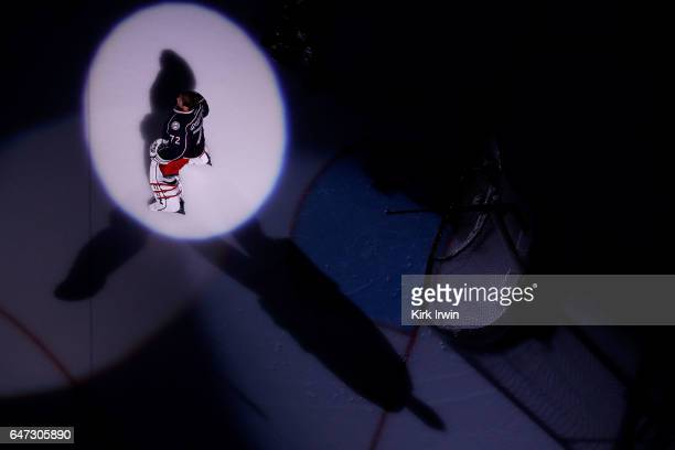 Sergei Bobrovsky of the Columbus Blue Jackets is spotlit during player introductions prior to the start of the game against the Minnesota Wild on...