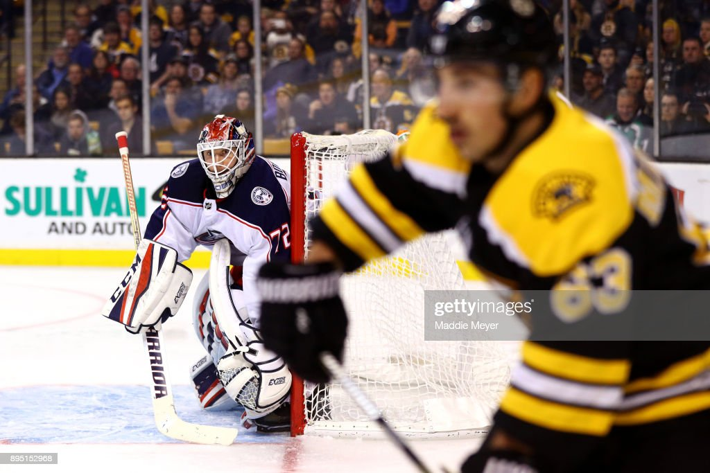 Sergei Bobrovsky #72 of the Columbus Blue Jackets keeps an eye on Brad Marchand #63 of the Boston Bruins during the third period at TD Garden on December 18, 2017 in Boston, Massachusetts. The Bruins defeat the Blued Jackets 7-2.
