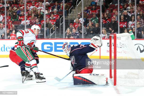 Sergei Bobrovsky of the Columbus Blue Jackets makes a save against Brett Seney of the New Jersey Devils at Prudential Center on December 23 2018 in...