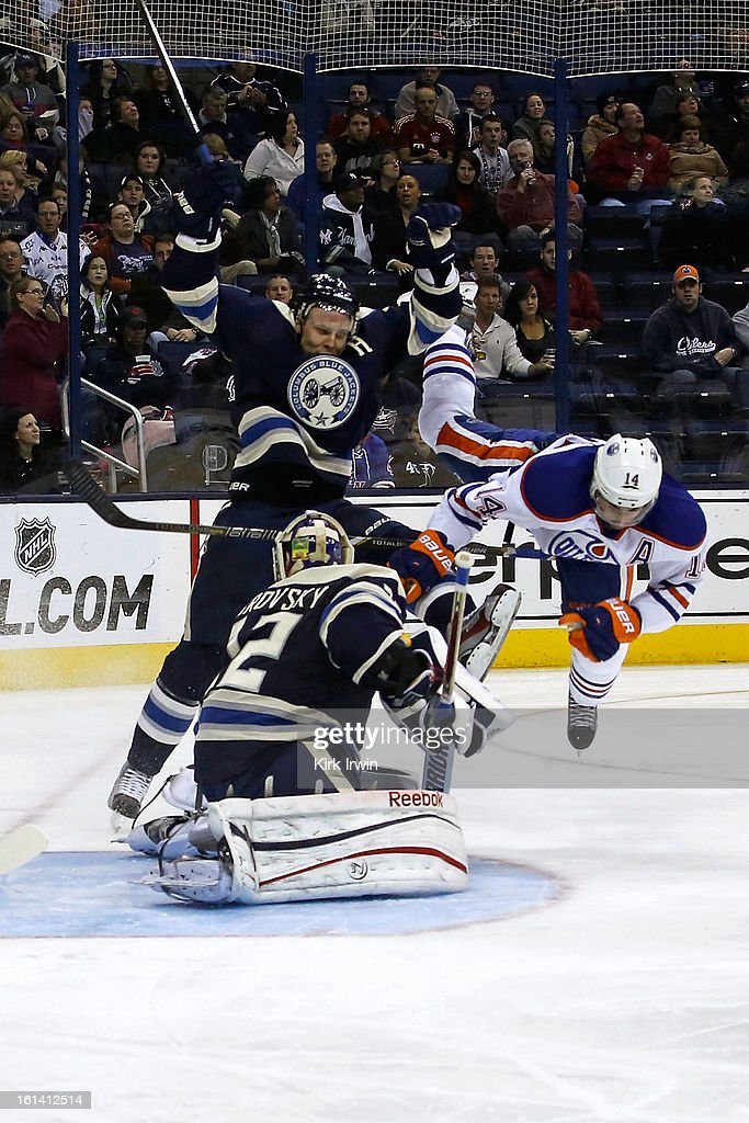 Sergei Bobrovsky #72 of the Columbus Blue Jackets makes a save as Jorden Eberle #14 of the Edmonton Oilers and Jack Johnson #7 of the Columbus Blue Jackets collide during the third period on February 10, 2013 at Nationwide Arena in Columbus, Ohio. Edmonton defeated Columbus 3-1.