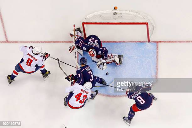 Sergei Bobrovsky of the Columbus Blue Jackets makes a save as Seth Jones of the Columbus Blue Jackets attempts to keep Alex Ovechkin of the...