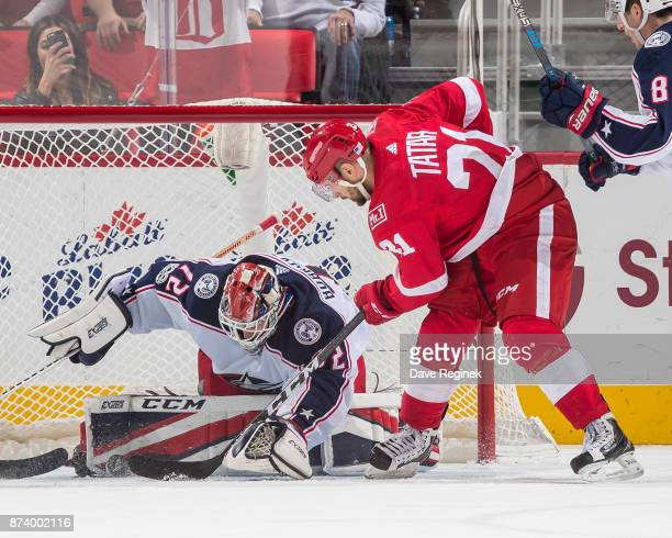 Sergei Bobrovsky of the Columbus Blue Jackets makes a save in overtime on Tomas Tatar of the Detroit Red Wings during an NHL game at Little Caesars...
