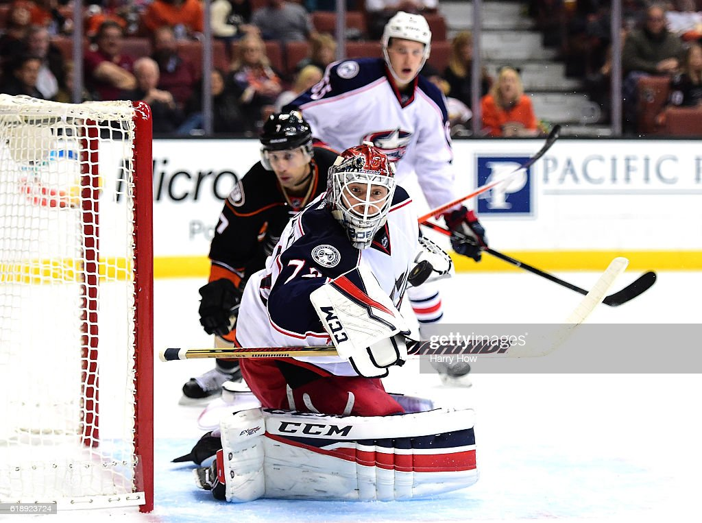 Sergei Bobrovsky #72 of the Columbus Blue Jackets makes a save on a shot from Andrew Cogliano #7 of the Anaheim Ducks during the first period at Honda Center on October 28, 2016 in Anaheim, California.