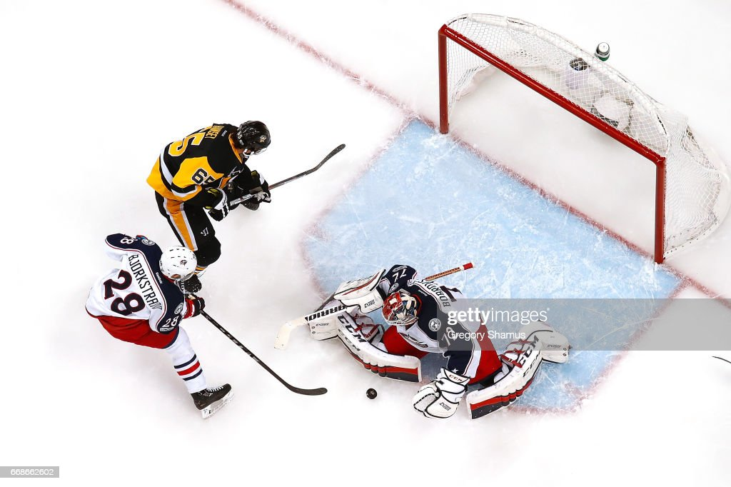 Sergei Bobrovsky #72 of the Columbus Blue Jackets makes a save on a shot by Ron Hainsey #65 of the Pittsburgh Penguins in Game Two of the Eastern Conference First Round during the 2017 NHL Stanley Cup Playoffs at PPG Paints Arena on April 14, 2017 in Pittsburgh, Pennsylvania. Pittsburgh won the game 4-1 to take a 2-0 series lead.