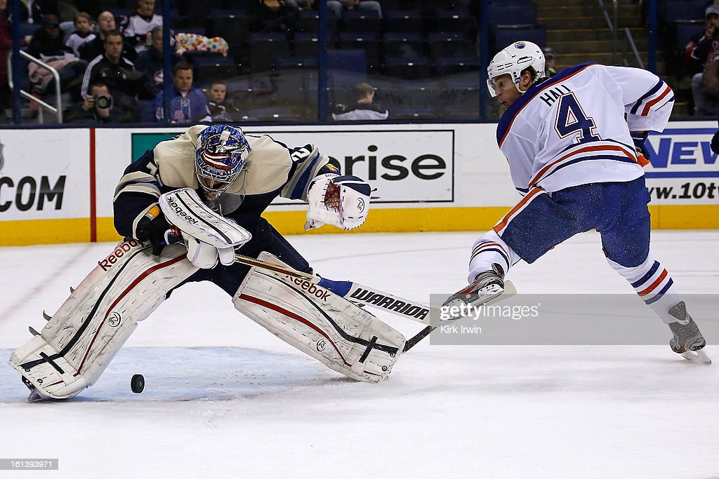 Sergei Bobrovsky #72 of the Columbus Blue Jackets makes a save on Taylor Hall #4 of the Edmonton Oilers but is unable to control the rebound during the first period on February 10, 2013 at Nationwide Arena in Columbus, Ohio.