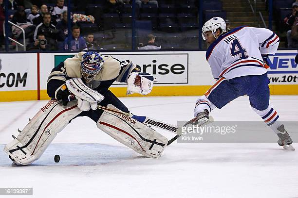 Sergei Bobrovsky of the Columbus Blue Jackets makes a save on Taylor Hall of the Edmonton Oilers but is unable to control the rebound during the...