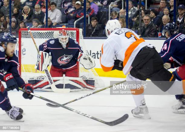 Sergei Bobrovsky of the Columbus Blue Jackets prepares to block a shot from Radko Gudas of the Philadelphia Flyers during the second period of the...