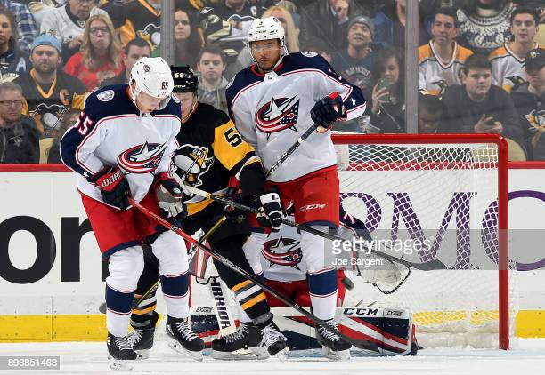 Sergei Bobrovsky of the Columbus Blue Jackets protects the net against Jake Guentzel of the Pittsburgh Penguins at PPG Paints Arena on December 21...