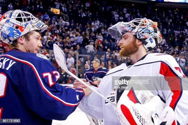 Sergei Bobrovsky of the Columbus Blue Jackets shakes hands with Braden Holtby of the Washington Capitals at the end of Game Six of the Eastern...