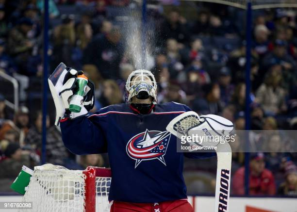 Sergei Bobrovsky of the Columbus Blue Jackets spits water out of his mount before the start of the third period of the game between the Columbus Blue...