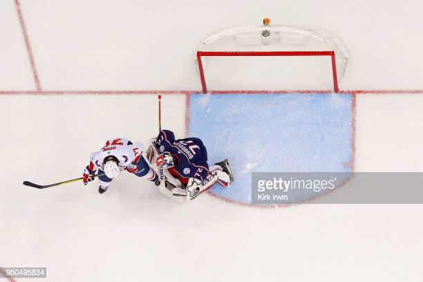 Sergei Bobrovsky of the Columbus Blue Jackets stops a deflected shot from TJ Oshie of the Washington Capitals in Game Four of the Eastern Conference...