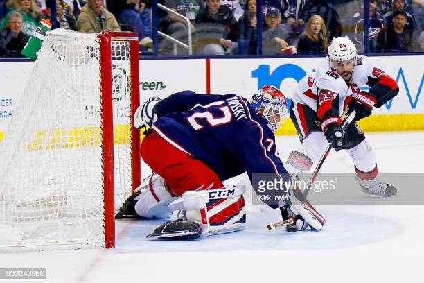Sergei Bobrovsky of the Columbus Blue Jackets stops a shot from Erik Karlsson of the Ottawa Senators during the first period on March 17 2018 at...