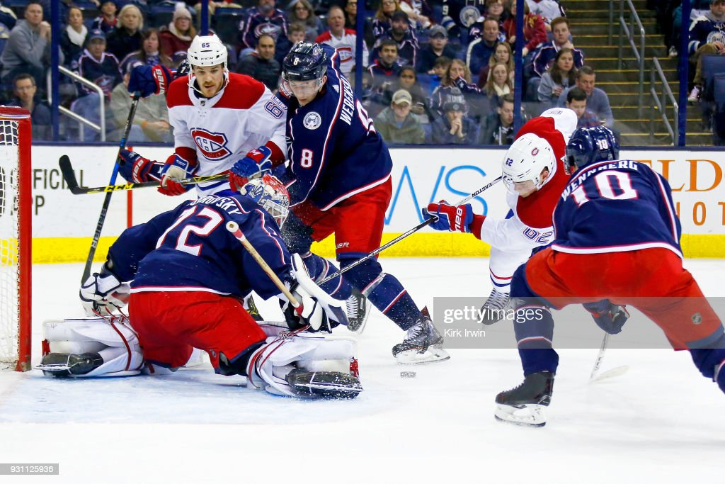 Sergei Bobrovsky #72 of the Columbus Blue Jackets stops a shot from Artturi Lehkonen #62 of the Montreal Canadiens as Alexander Wennberg #10 of the Columbus Blue Jackets looks to control the rebound during the third period on March 12, 2018 at Nationwide Arena in Columbus, Ohio. Columbus defeated Montreal 5-2.