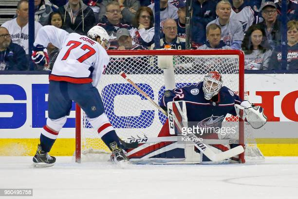 Sergei Bobrovsky of the Columbus Blue Jackets stops a shot from TJ Oshie of the Washington Capitals in Game Four of the Eastern Conference First...