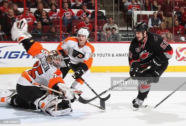 Sergei Bobrovsky of the Philadelphia Flyers deflects the puck and makes the save against a shot by Chad LaRose of the Carolina Hurricanes during a...
