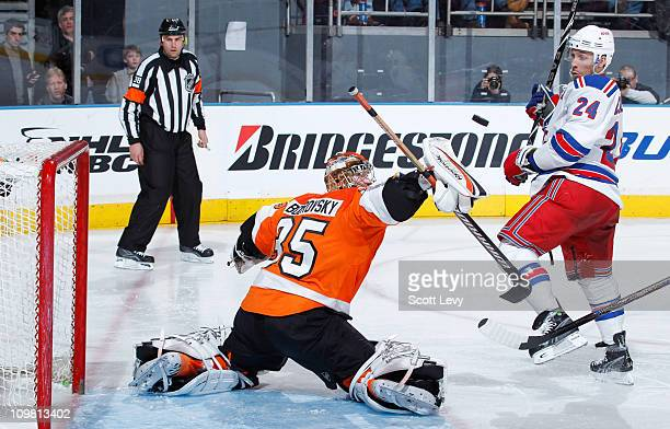 Sergei Bobrovsky of the Philadelphia Flyers protects the net in the third period against Ryan Callahan of the New York Rangers on March 6 2011 at...
