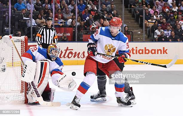 Sergei Bobrovsky reaches for a glove save with Evgeny Kuznetsov of Team Russia in front during the World Cup of Hockey 2016 at Air Canada Centre on...