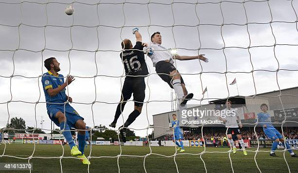 Sergei Chernikof BATE Borisov punches clear from Brian Gartland of Dundalk during the Champions League 2nd round qualifying game at Oriel Park on...