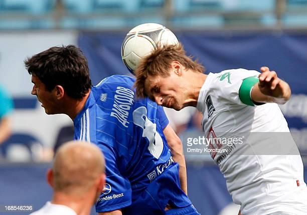 Sergei Davydov of FC Dynamo Moscow is challenged by Alyaksandr Martynovich of FC Krasnodar during the Russian Premier League match between FC Dynamo...