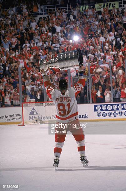 Sergei Fedorov of the Detroit Redwings holds the Stanley Cup in victory over their win against the Philadelphia Flyers circa 1997 at the Joe Louis...