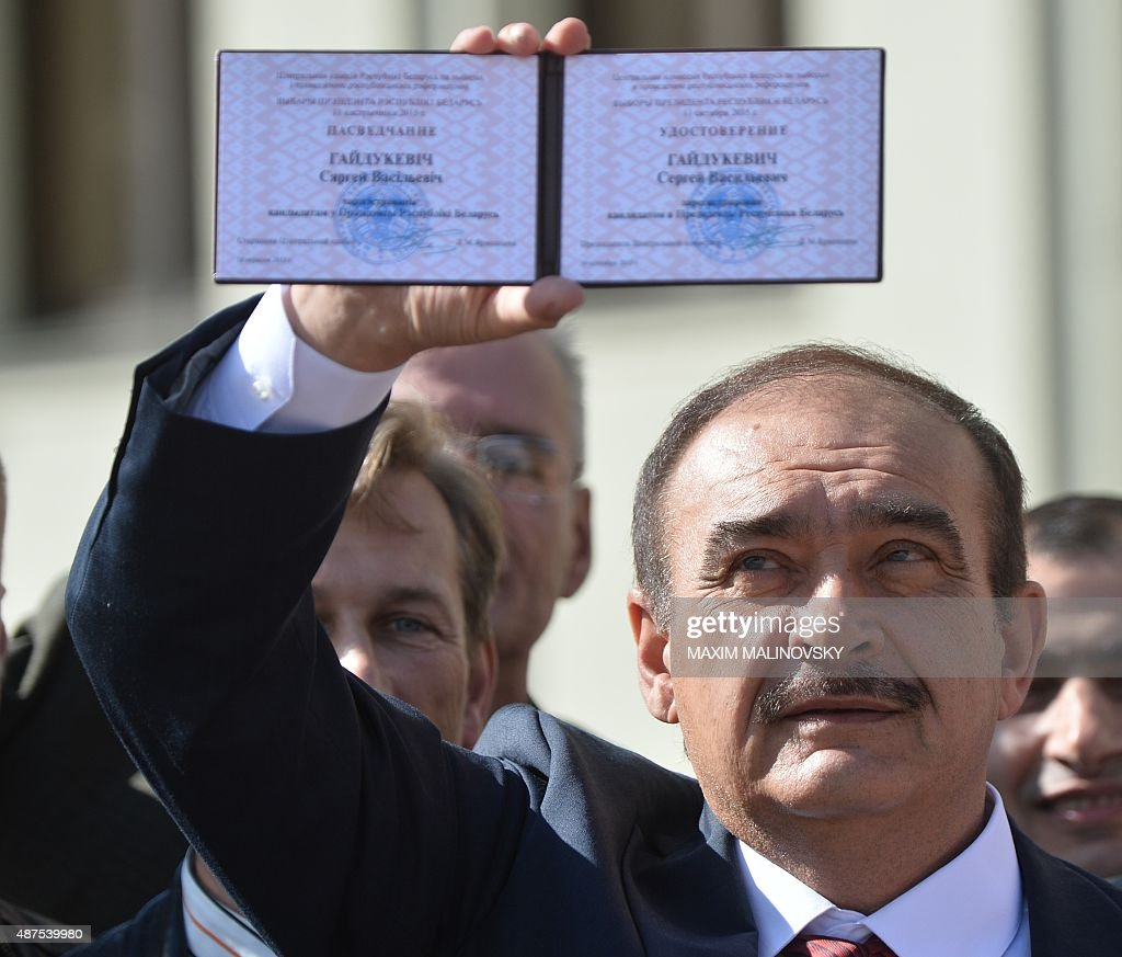 Sergei Gaidukevich shows a presidential candidate's certificate ...