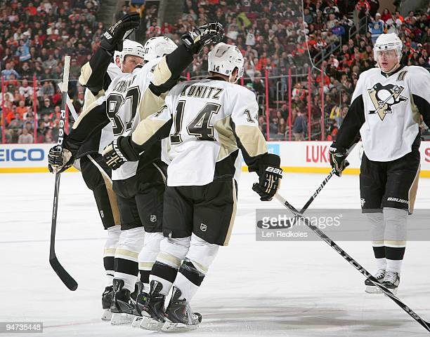 Sergei Gonchar Sidney Crosby Chris Kunitz and Evgeni Malkin of the Pittsburgh Penguins celebrate Crosby's secondperiod goal against the Philadelphia...