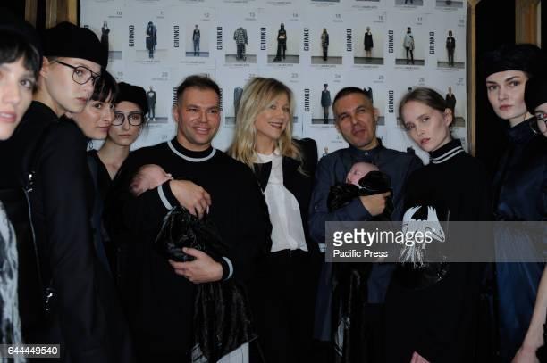 Sergei Grinko Natasha Stefanenko Filippo Cocchetti with the models in the backstage during the Milan fashion week F/W 20172018