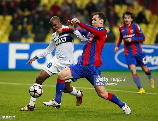 Sergei Ignashevich of CSKA Moscow battles for the ball with Samuel Eto'o of FC Internazionale Milano during the UEFA Champions League Quarter Finals,...