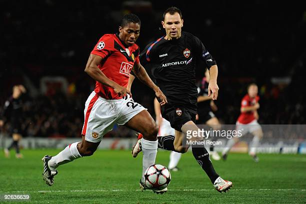 Sergei Ignashevich of CSKA Moscow competes for the ball with Antonio Valencia of Manchester United during the UEFA Champions League Group B match...