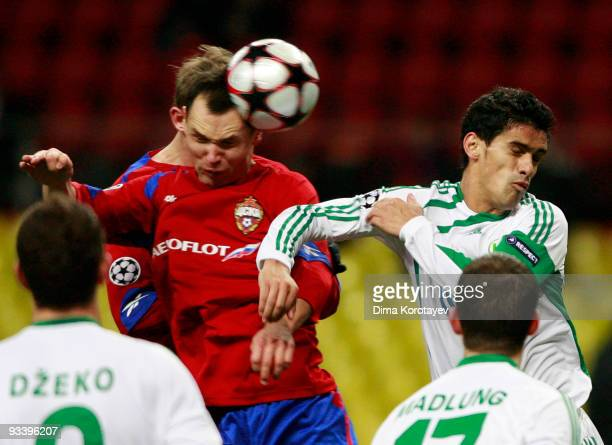 Sergei Ignashevich of CSKA Moscow fights for the ball with Ricardo Costa of VfL Wolfsburg during the UEFA Champions League group B match between CSKA...