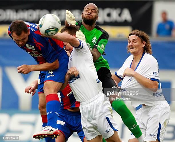 Sergei Ignashevich of PFC CSKA Moscow battles for the ball with Rais M'Bolhi Ivan Taranov and Nejc Pecnik of FC Krylia Sovetov Samara during the...