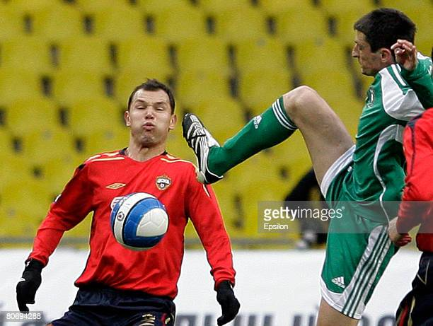 Sergei Ignashevich of PFC CSKA Moscow challenges for the ball with Goran Maznov of FC Tom Tomsk during the Russian Cup semifinal football match...