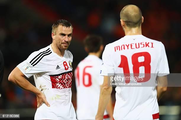 Sergei Kornilenko of of Belarus speaks to team mate Ivan Mayevski during the FIFA 2018 World Cup Qualifier between Netherlands and Belarus held at De...