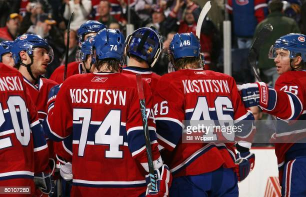 Sergei Kostitsyn and his brother, Andrei Kostitsyn of the Montreal Canadiens celebrate a win against the Buffalo Sabres on February 29, 2008 at HSBC...