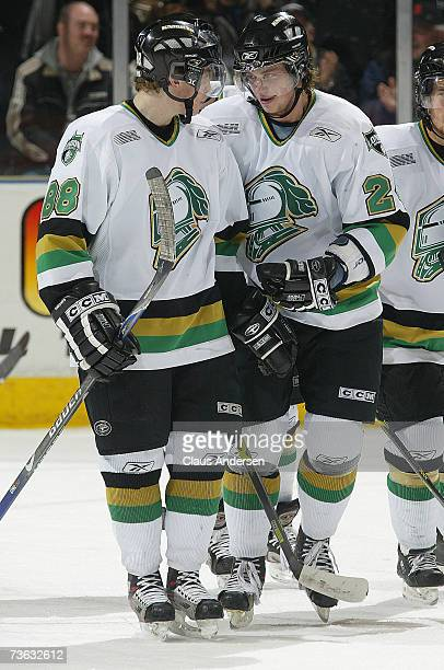 Sergei Kostitsyn congratulates teammate Patrick Kane of the London Knights after Kane scored his fourth goal of game against the Erie Otters at the...