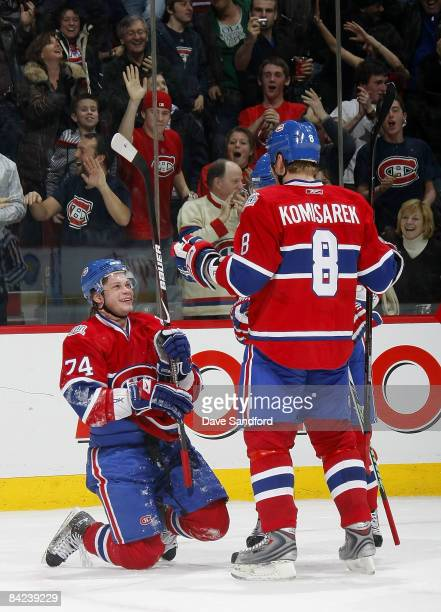 Sergei Kostitsyn of the Montreal Canadiens is all smiles as he is congratulated by teammate Mike Komisarek after he scored the game winning goal...