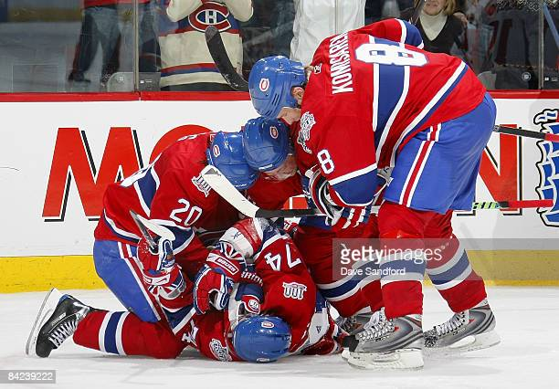 Sergei Kostitsyn of the Montreal Canadiens is mauled by his teamates Mike KomisarekAndrei Kostitsyn and Robert Lang after he scored the game winning...
