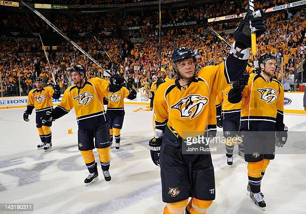 Sergei Kostitsyn of the Nashville Predators and teammates salute the fans after the series clinching win against the Detroit Red Wings in Game Five...