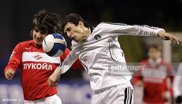 Sergei Kovalchuk of FC Spartak Moscow competes for the ball with Goran Maznov of FC Tom Tomsk during the Russian Football League Championship match...