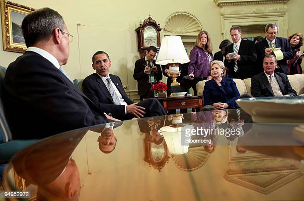 Sergei Lavrov Russia's foreign minister left and US President Barack Obama second from left address the media following a meeting in the Oval Office...