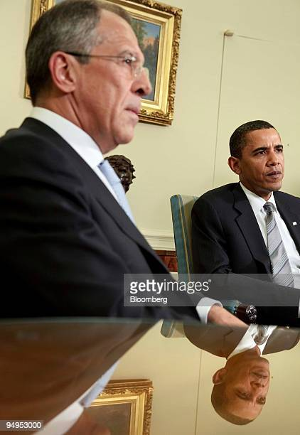 Sergei Lavrov Russia's foreign minister left and US President Barack Obama speak during a meeting in the Oval Office of the White House in Washington...