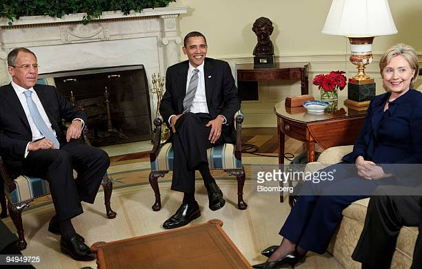 Sergei Lavrov Russia's foreign minister left US President Barack Obama center and Hillary Clinton US secretary of state wait to speak to the media...