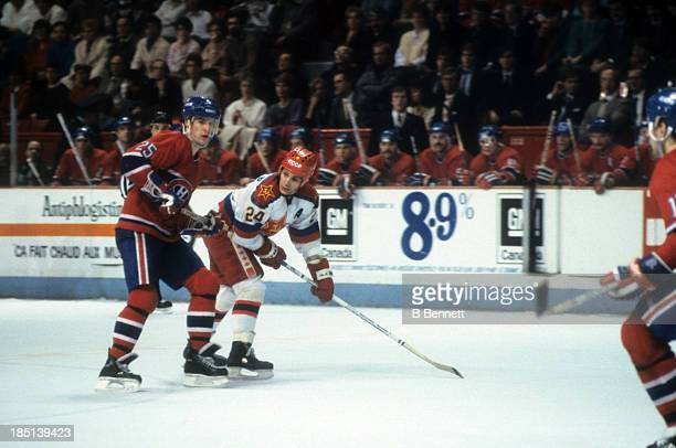 Sergei Makarov of CSKA Moscow skates on the ice as he is defended by Petr Svoboda of the Montreal Canadiens during the 1985-86 Super Series on...