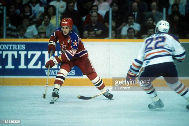 Sergei Makarov of CSKA Moscow skates with the puck as he is defended by Charlie Huddy of the Edmonton Oilers during the 1985-86 Super Series on...