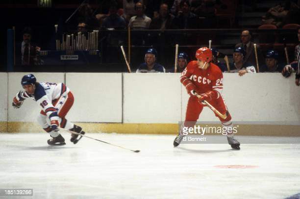 Sergei Makarov of the USSR and Mark Pavelich of Team USA go for the puck during an 1980 exhibition game on February 9 1980 at the Madison Square...