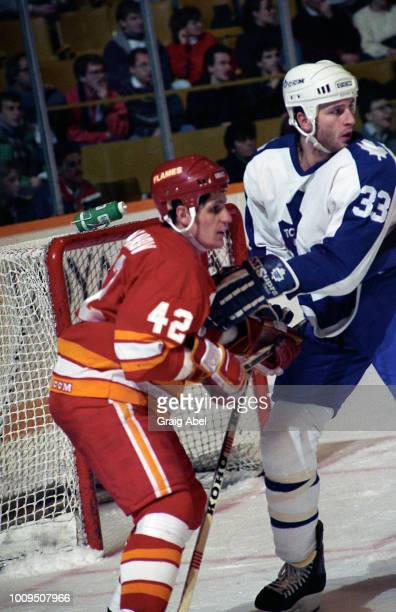 Sergei Markov of the Calgary Flames skates against Al Iafrate the Toronto Maple Leafs during NHL game action January 13 1990 at Maple Leaf Gardens in...
