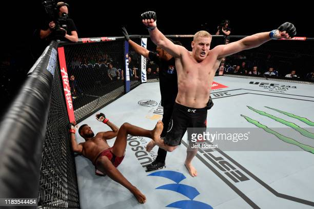 Sergei Pavlovich of Russia celebrates his TKO victory over Maurice Greene in their heavyweight bout during the UFC Fight Night event at Singapore...