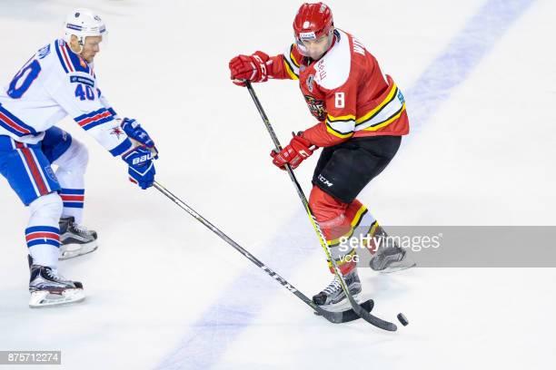 Sergei Peretyagin of HC Kunlun Red Star and Nikita Gusev of SKA Saint Petersburg vie for the puck during the 2017/18 Kontinental Hockey League...