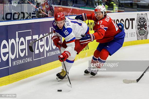 Sergei Plotnikov of Russia and Alexander Bonsaksen of Norway battle for the puck during the IIHF World Championship group B match between Russia and...