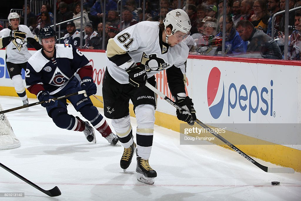 Sergei Plotnikov #61 of the Pittsburgh Penguins controls the puck against the Colorado Avalanche at Pepsi Center on December 9, 2015 in Denver, Colorado. The Penguins defeated the Avalanche 4-2.